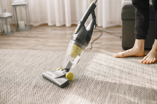 girl-cleaning-house-with-vacuum-cleaner_1157-46766